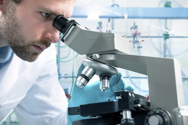 Microscope and scientist people istock